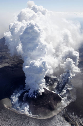 Ash billows as a lava dome builds in Shinmoedake peak on Mount Kirishima on Monday morning, dusting wide parts of Miyazaki and Kagoshima prefectures. KYODO PHOTO, japantimes